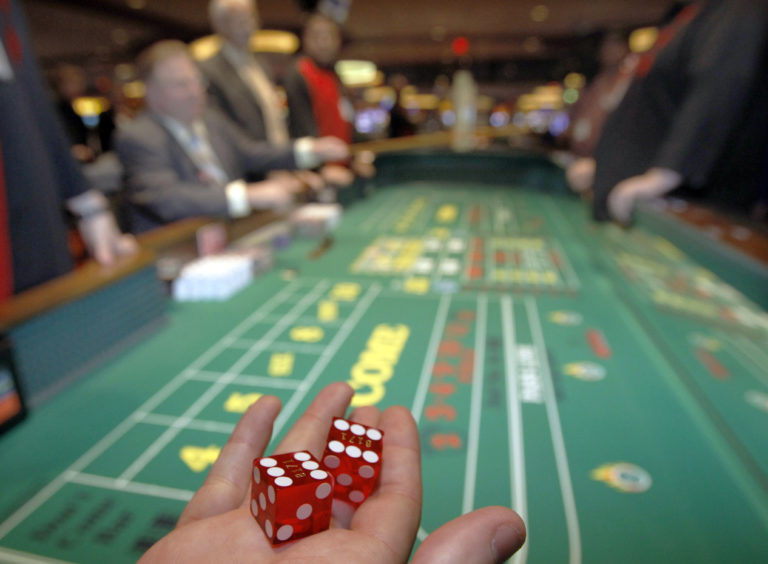 Public relations manager David LaTorre shows dice before he tosses them during a demonstration at the craps table at the Meadows Racetrack and Casino during a media tour in Meadowlands, Pa., Tuesday, July 6, 2010. Some Pennsylvania casinos are going through the final tests before the scheduled opening of table games on July 8. (AP Photo/Keith Srakocic)